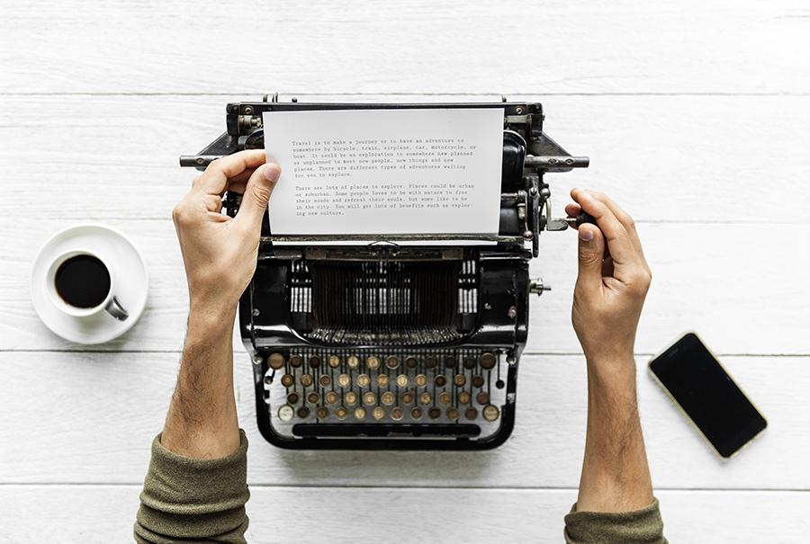 Person using a typewriter writing a subpoena