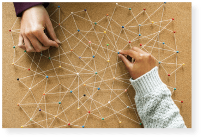 picture of hands connecting dots to show management of a process