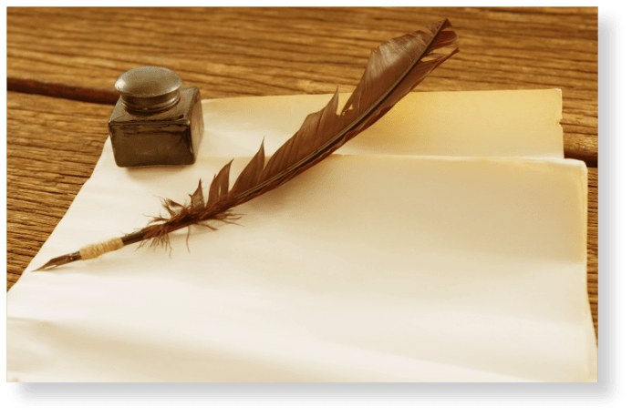 picture of paper and pen with an ink pot for a signature